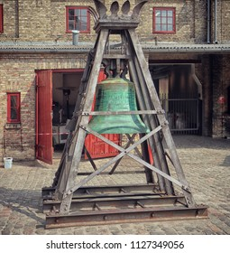 COPENHAGEN, DENMARK - MAY 18, 2018 the Old Carlsberg brewery in Copenhagen: the brewhouse bronze bell dated 1887 in exposition in the yard