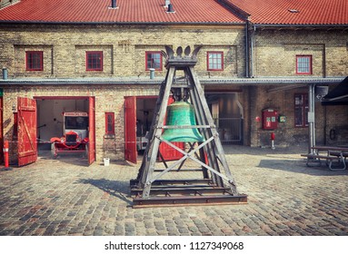 COPENHAGEN, DENMARK - MAY 18, 2018 the yard of the Old Carlsberg brewery in Copenhagen with the brewhouse bronze bell dated 1887 in exposition