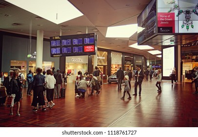 COPENHAGEN, DENMARK - MAY 19, 2018 Copenhagen international airport, travelers  traffic in the aisle of the terminal gate zone