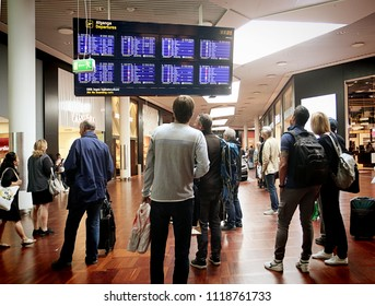 COPENHAGEN, DENMARK - MAY 19, 2018 Copenhagen international  airport,travelers look at the departure board in the  terminal gate zone