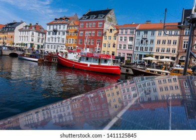 Copenhagen, Denmark - May 20, 2019: View of old Nyhavn port in the central Copenhagen. Boats and colorful architecture