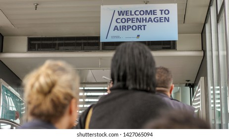 Copenhagen, Denmark - May 20 2019: A sign welcoming travelers from the trainstation up in the Copenhagen airport departure hall via a escalator.