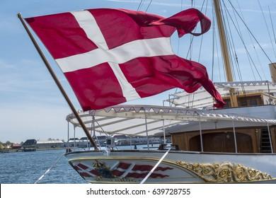 "COPENHAGEN, DENMARK – MAY 2017: The royal ship ""Dannebrog"" moored at the Amalie quay in the Copenhagen Port. ""Dannebrog"" is also the name of the flag."