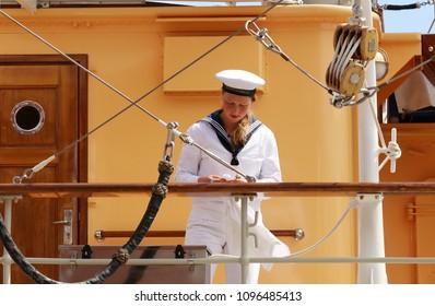 COPENHAGEN, DENMARK - MAY 22, 2018 : The crew of the Danish royal yacht Dannebrog. Port of Copenhagen, Denmark.