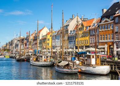 COPENHAGEN, DENMARK - MAY 23: Nyhavn district is one of the most famous and beautiful landmark in Copenhagen, Denmark in a sunny day on May 23, 2017