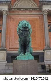 COPENHAGEN, DENMARK - May 25, 2019: Statue of a lion near Ny Carlsberg Glyptotek in Copenhagen