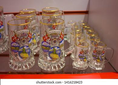 COPENHAGEN, DENMARK - May 25, 2019: Glass souvenir cups in the souvenir shop of Copengagen