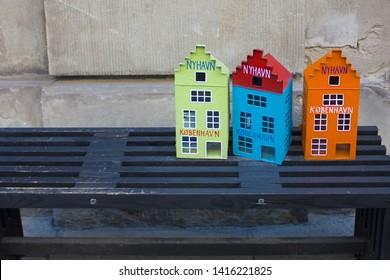 COPENHAGEN, DENMARK - May 25, 2019: Traditional souvenir toys small houses in the souvenir shop of Copengagen