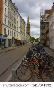 COPENHAGEN, DENMARK - May 25, 2019: Church Our Saviour and bicycle parking in Copenhagen