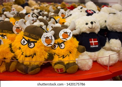 COPENHAGEN, DENMARK - May 25, 2019: Soft souvenir toy «Angry Viking» and plush bears at display of a souvenir shop