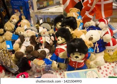COPENHAGEN, DENMARK - May 25, 2019: Soft souvenir toy «Viking» and plush bears at display of a souvenir shop