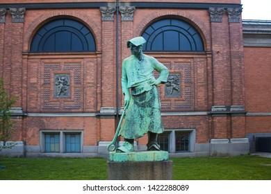 COPENHAGEN, DENMARK - May 25, 2019: Hammersmed Statue near Ny Carlsberg Glyptotek in Copenhagen
