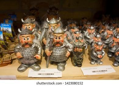 COPENHAGEN, DENMARK - May 25, 2019: Small souvenir toys «Viking» at display in souvenir store in Copenhagen