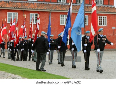 """COPENHAGEN, DENMARK - MAY, 29, 2017:This is happening at a veteran event in Kastellet, Copenhagen, on """"The International Day of United Nations Peacekeepers. The Citadel. The Flag of Denmark."""
