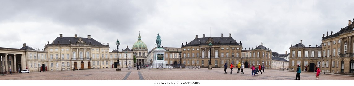 COPENHAGEN, DENMARK - MAY 31, 2017: Panoramic view of Amalienborg Slotsplads square with equestrian statue of Amalienborg's founder, King Frederick V and Frederik's Church on background, Copenhagen