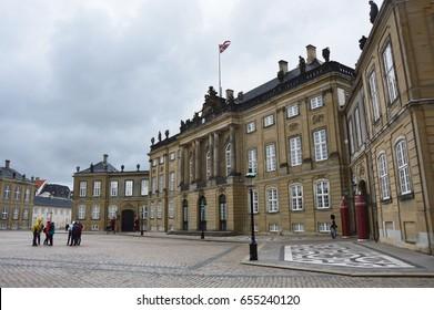 COPENHAGEN, DENMARK - MAY 31, 2017: Amalienborg Slotsplads square with Royal Guards and tourists, Copenhagen, Denmark