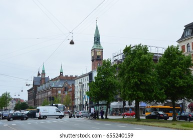 COPENHAGEN, DENMARK - MAY 31, 2017: H. C. Andersens Boulevard the most densely trafficated artery in central Copenhagen with the tower clock of Copenhagen City Hall on the background, Denmark