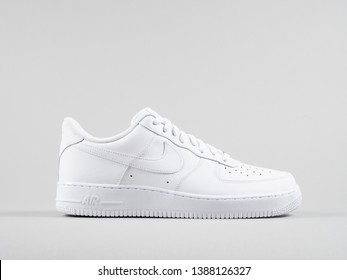 Copenhagen, Denmark - May 4, 2019: Nike Air Force 1 '07 white sneakers product shot isolated on light grey background. Illustrative editorial photo.