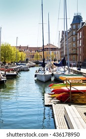 COPENHAGEN, DENMARK - MAY 7, 2016View of Christianshavn from one of the sea channels crossing the quarter: ancient merchant town, now incorporated in Copenhagen and part of the harbor
