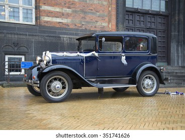 COPENHAGEN, DENMARK - NOVEMBER 01, 2014: Vintage Ford car with wedding ribbons