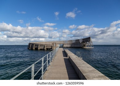 Copenhagen, Denmark - October 03, 2018: Kastrup Sea Bath, a circular wooden structure with seating around a seawater pool