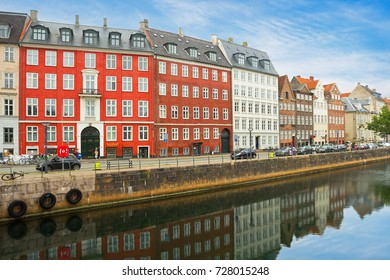 Copenhagen, Denmark - October 1, 2017: Typical street by the canal with colorful old buildings in Copenhagen.