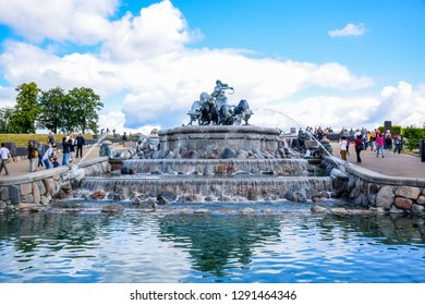 COPENHAGEN, DENMARK - OCTOBER 16: Tourists are visiting the Gefion Fountain, a large-scale group of animal figures being driven by the Norse goddess Gefjon located in Langelinie, Copenhagen