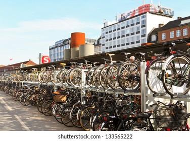 COPENHAGEN, DENMARK - OCTOBER 19: Center of Copenhagen. Many bicycles parked in front of the metro station on Oct 19, 2012 in Copenhagen, Denmark.