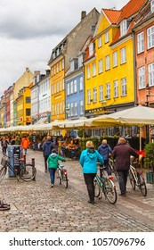 COPENHAGEN, DENMARK - OCTOBER 7, 2016: Nyhavn district is one of the most famous landmarks in Copenhagen with typical colorful houses and water canals.