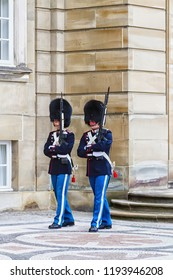COPENHAGEN, DENMARK - OCTOBER 9, 2016:.Soldiers of the Royal Guard in Amalienborg Castle guarding the entrance in Copenhagen, Denmark