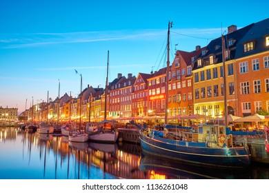 Copenhagen, Denmark on the Nyhavn Canal at night.