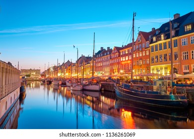 Copenhagen, Denmark on the Nyhavn Canal at night.