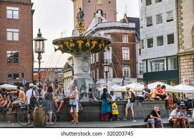 Copenhagen, Denmark. People by the Caritas Fountain getting chill. Taken on 2015/07/05