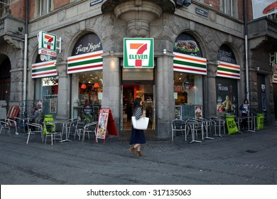 COPENHAGEN, DENMARK - SATURDAY, AUGUST 22, 2015: Pedestrians walk past a 7-Eleven convenience store in Copenhagen.