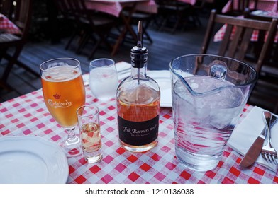 Copenhagen, DENMARK - Sep 2014 : Carlsberg beer & aquavit in a restaurant