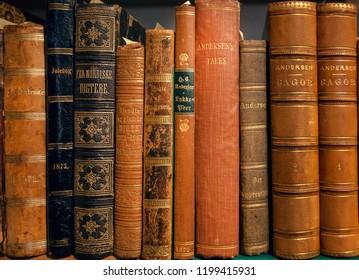 COPENHAGEN, DENMARK - SEPT 4: Bookshelf with fairy tales by danish writer Hans Christian Andersen, printed in 19th century on 4 September, 2018. Copenhagen has 94,000 students enrolled in universities