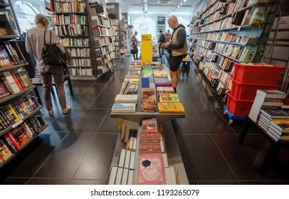 COPENHAGEN, DENMARK - SEPT 4: Bookstore customers leaf through new fiction books inside modern bookshop on 4 September, 2018. Copenhagen has 94,000 students enrolled in universities