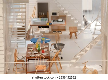 COPENHAGEN, DENMARK - SEPT 5: Apartment flat side view, paper and cardboard layout, with toy furniture and model of interior design on 5 September, 2018. Copenhagen has 94,000 students in universities