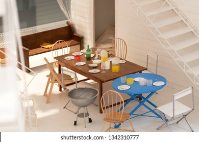 COPENHAGEN, DENMARK - SEPT 5: Dinner time in apartment flat, paper and cardboard layout, with toy furniture and model of interior on 5 September, 2018. Copenhagen has 94,000 students in universities