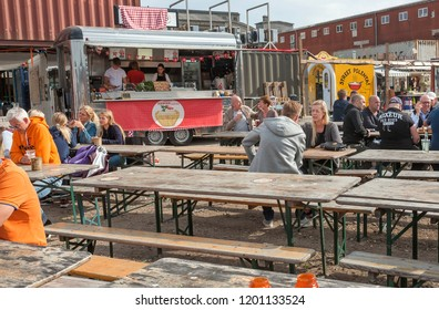 COPENHAGEN, DENMARK - SEPT 7: Many people meeting around tables and eating fast food at street market Reffen, urban area for start-ups on 7 September, 2018. Copenhagen has population near 1.3 million
