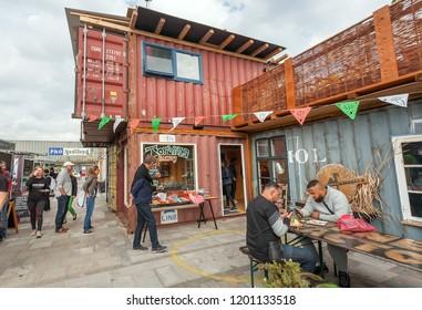 COPENHAGEN, DENMARK - SEPT 7: People eating fast food at popular market Reffen, street food and urban area for start-ups, on 7 September, 2018. Copenhagen has population near 1.3 million