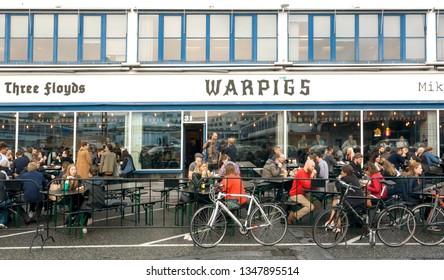 COPENHAGEN, DENMARK - SEPT 7: People drinking craft beer outdoor, at bar of historical meat market on 7 September, 2018. Copenhagen has population near 1.3 million