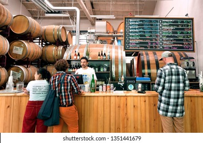 COPENHAGEN, DENMARK - SEPT 9: Visitors of craft beer bar making choice at bar counter and buying drinks on 9 September, 2018. Mikkeller is a microbrewery founded in 2006