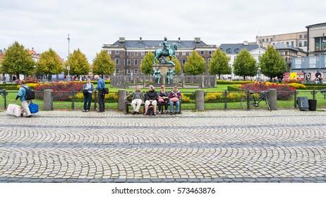 COPENHAGEN, DENMARK - SEPTEMBER 10, 2011: Kongens Nytorv (King's New Square) with statue King Christian V in Copenhagen city in autumn day. Kongens Nytorv is public square at the end of street Stroget