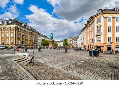 Copenhagen, Denmark - September 10 2018: Tourists and local Danes enjoy a summer day in the city center as they pass by the equestrian statue of Absalon on Hojbro plads near Christiansborg Palace