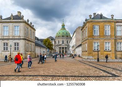 Copenhagen, Denmark - September 11 2018: Tourists visit the Amalienborg Palace square and head towards Frederik's Church in the center of Copenhagen, Denmark.