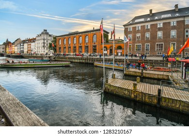 Copenhagen, Denmark - September 13 2018: A tour boat filled with tourists turns around to dock in the Nyhavn canal in Copenhagen, Denmark.