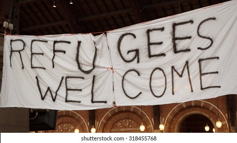 COPENHAGEN, DENMARK - SEPTEMBER 17, 2015: Handmade banner Refugees Welcome is hanged in Copenhagen railroad station by the place where locals bring clothes for refugees.