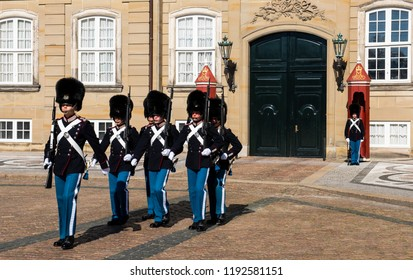 Copenhagen, Denmark - September 18, 2018: Changing of the Royal Guards at Amalienborg, the palace and residence in Copenhagen of the queen of Denmark.