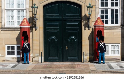 Copenhagen, Denmark - September 18, 2018: Two Royal Guards at Amalienborg, the palace and residence in Copenhagen of the queen of Denmark.